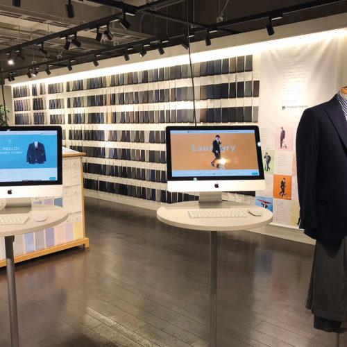 Maßanzüge am Bildschirm konfigurieren, gesehen in der Modi Mall in Shibuya (Foto: dlv)